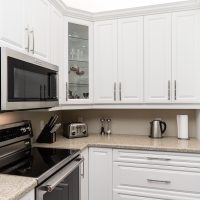 white and glass cabinets in kitchen