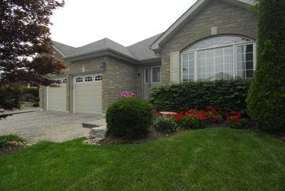 custom home with garage doors with windows